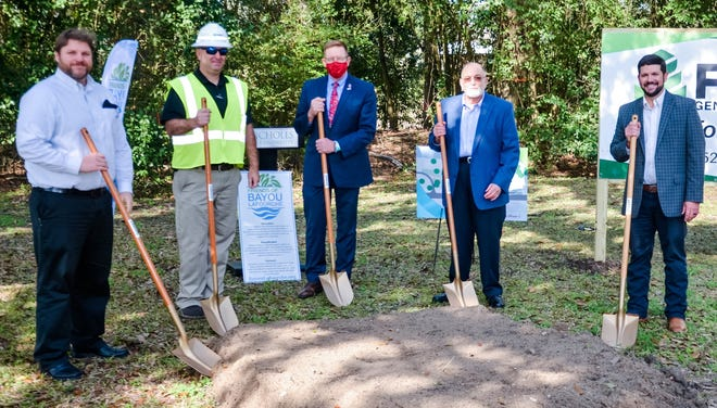 The groundbreaking ceremony for Phase 1 of the bayouside park project at Nicholls State University. From left: Matthew Thornton from T. Baker Smith, Benton Foret of Foret Group, Nicholls President Jay Clune, Chris Terracina of the Lorio Foundation and Ryan Perque of Friends of Bayou Lafourche.