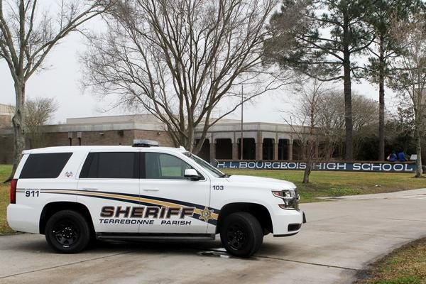 A Terrebonne Parish sheriff's unit parks in front of H.L. Bourgeois High School in an undated file photo.