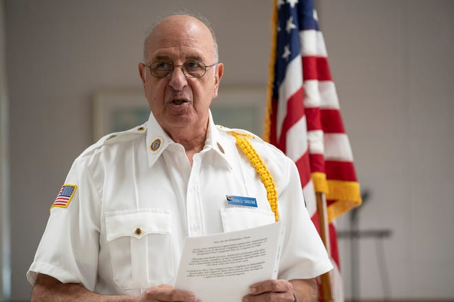 Don Sansone reads the history of Lt. George L. Fox at the American Legion Post 76 meeting in Tavares.