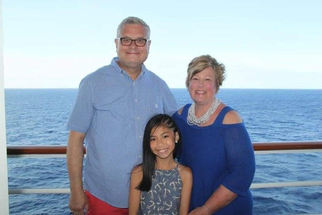 Union Grove Baptist Church minister Ken Harris passed away Wednesday after battling with COVID-19 for several weeks. He is pictured with his wife, Kim, and their daughter, Claire.