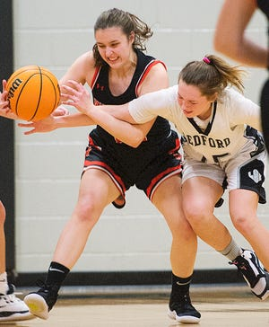 Ledford's Ashley Limbacher (right) tries to steal the ball from North Davidson's Cayden Dally in a game last season. Limbacher and the Panthers beat Reagan on Wednesday to remain undefeated. [DONNIE ROBERTS/THE DISPATCH]