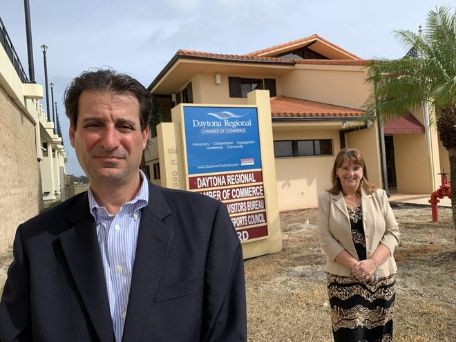 Len Marinaccio III, left, the newly installed 2021 board chair for the Daytona Regional Chamber of Commerce, stands in front of the chamber office on Daytona Beach's City Island with chamber CEO Nancy Keefer, right, on Tuesday, Jan. 26, 2021. Marinaccio is the president of Bomar Construction Inc. in Ormond Beach, a general contractor firm he runs with his Dad, Len Marinaccio Jr.