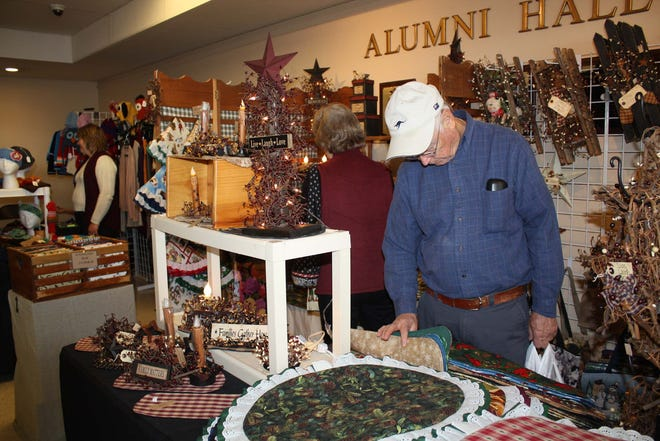 A shopper checks out the offerings at a past Herkimer County Arts & Crafts Fair at Herkimer County Community College. This year's event, like last year's, has been canceled due to the coronavirus pandemic.