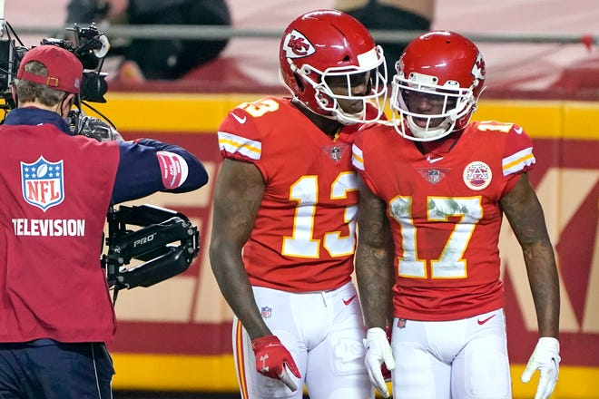 Kansas City Chiefs wide receiver Mecole Hardman (17) celebrates with teammate Byron Pringle (13) after catching a 3-yard touchdown pass during the first half of the AFC championship. Hardman atoned for a muffed punt earlier in the game with some big plays in the 38-24 win.