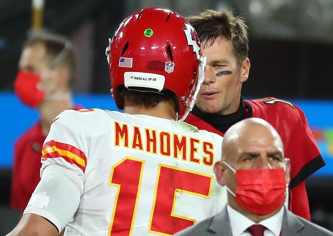 Kansas City Chiefs quarterback Patrick Mahomes meets with Tampa Bay Buccaneers quarterback Tom Brady following the Chiefs' regular season win in Tampa. The two will match up again in Super Bowl 55 on Sunday, Feb. 7, 2021.