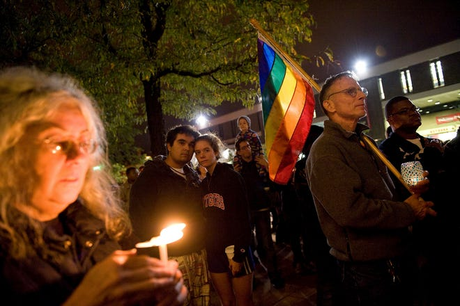 In this Oct. 3, 2010 file photo, people participate in a candlelight vigil for Rutgers University freshman Tyler Clementi on the Rutgers campus in New Brunswick, N.J. Declaring 'God is on your side,' a Roman Catholic cardinal, an archbishop and six other U.S. bishops issued a statement Monday, expressing support for LGBT youth and denouncing the bullying often directed at them. (AP Photo/Reena Rose Sibayan, File)