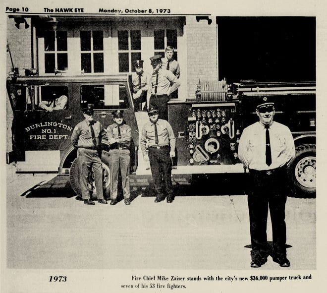 In a Hawk Eye photo dated Oct. 8, 1973, Burlington Fire Chief Mike Zaiser stands with the city's new $36,000 pumper truck and seven of his 53 firefighters.