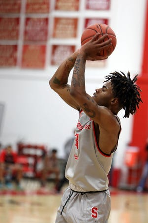 Southeastern Community College's Jimmy Beane (23) puts up a shot during the first half of their game against Indian Hills Community College, Wednesday Jan. 27, 2021 at Loren Walker Arena.