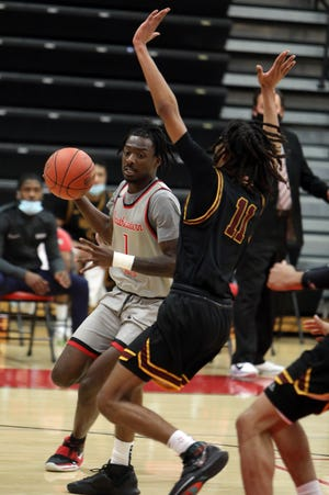 Southeastern Community College's Koby Isaac (1) drives to the basket past Curtis Jones (11) during the first half of their game against Indian Hills Community College, Wednesday Jan. 27, 2021 at Loren Walker Arena.