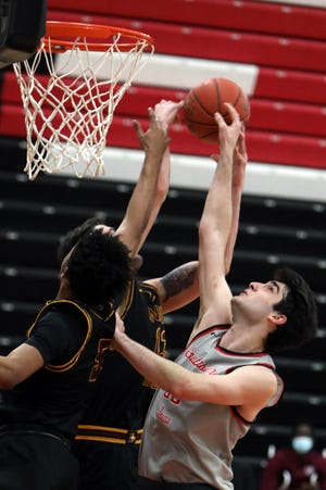 Southeastern Community College's Zurabi Zhgenti (33) goes after the rebound during the first half of their game against Indian Hills Community College, Wednesday Jan. 27, 2021 at Loren Walker Arena.