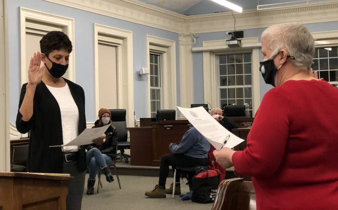 Marcia Gasses, left, is sworn in as Dover's Ward 4 city councilor Wednesday, Jan. 27, 2021.