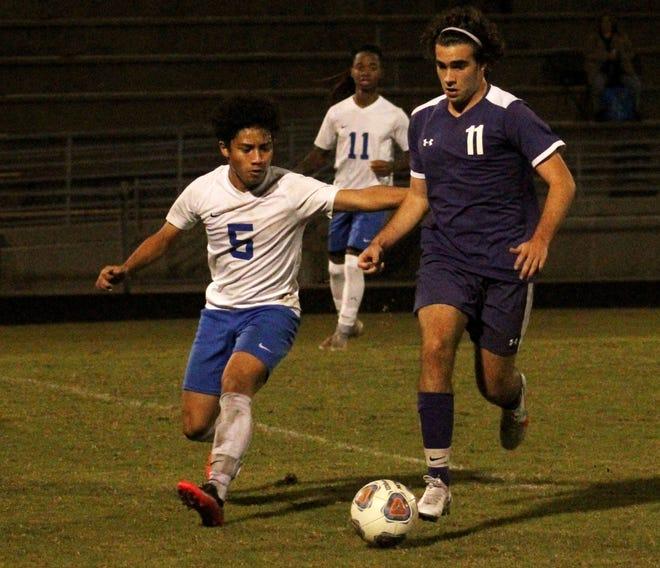 Fletcher midfielder Ryan Svela (11) dribbles upfield as Stanton midfielder Joseph Alberto (5) defends during a high school boys soccer game on November 17, 2020. [Clayton Freeman/Florida Times-Union]