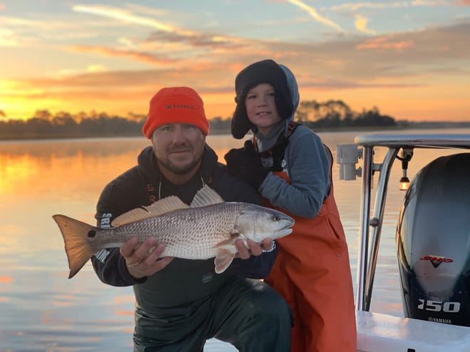 This father-son duo with a beautiful Palm Valley redfish they caught with Capt. Leon Dana.