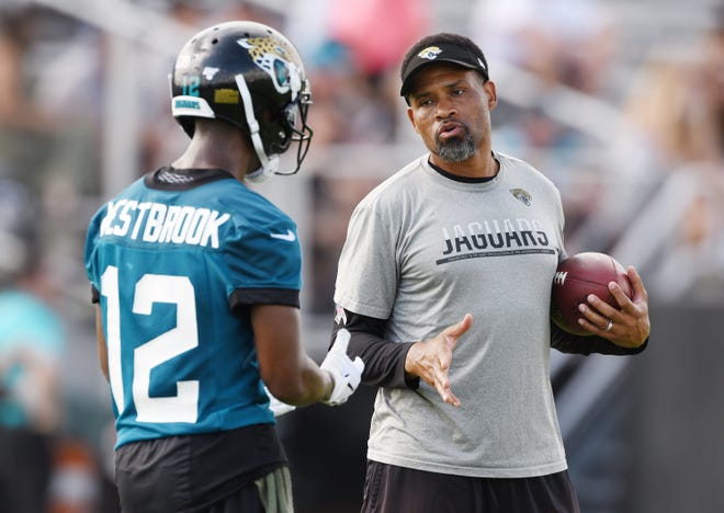 Jaguars #12, Dede Westbrook gets instructions from wide receivers coach Keenan McCardell during Tuesday morning's minicamp session. Bob Self/Florida Times-Union