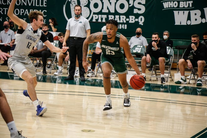 Tyreese Davis of Jacksonville University drives on Ryan Burkhardt of the University North Florida during their game on Jan. 9 at Swisher Gym. The split of their doubleheader is one of six this season in the ASUN.