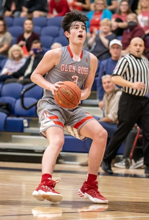 Glen Rose's Cross Arrington gets ready to pull up for a jumper against Stephenville on Tuesday. He scored a game-high 19 points in the win.