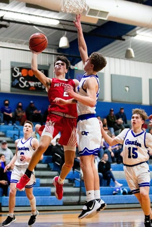 Pottsboro's Aidan Cannon drives to the basket during the Cardinals' victory at Gunter in District 11-3A action.