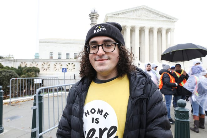 """Portuguese """"Dreamer"""" Rodrigo Pimentel, of East Providence, poses for a photo at a rally held in 2019 in front of the Supreme Court of the United States, where arguments were being heard about the Deferred Action for Childhood Arrivals program or DACA."""