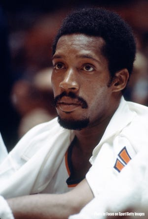 In this photo provided by the New York Knicks, Harthorne Wingo sits on the sidelines during a game in the 1970s.