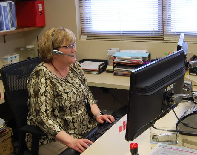 Kathy Winger, an administrative assistant at the Reno County Health Department, returns a call to an individual wanting to register for the COVID-19 vaccine. Eleven staff and volunteers at the department have processed more than 4,000 registrations since Tuesday and are now finishing up filling the 700 appointment slots for Friday's POD vaccination event.