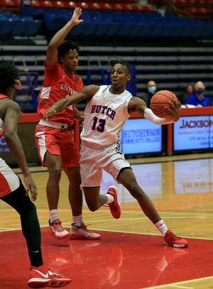 Hutchinson Community College's Josh Baker (13) drives past Coffeyville's Love Bettis (10) during their game Wednesday evening at the Sports Arena. Coffeyville defeated HCC 88-68.