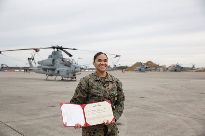 Lance Cpl. Alyssa David poses with her Navy and Marine Corps Commendation Medal citation following a ceremony at MCAS New River, Jan. 22.