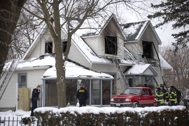 Firefighters work in the 700 block of West Oakton Street in Des Plaines, Jan. 27, 2021, where four young children and one adult died.