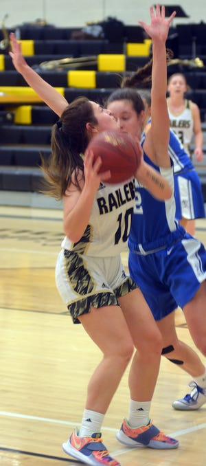 Newton senior Marah Zenner scored 14 points to lead the Railers in a 55-40 loss to 10th-ranked Kapaun-Mt. Carmel. Newton hosts Andover Central at 5 p.m. Friday.
