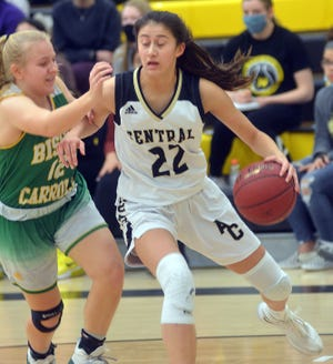Andover Central junior Brittany Harshaw handles the ball at the baseline during play Wednesday against Bishop Carroll.