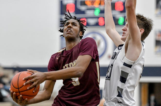 Stow-Munroe Falls' Marvin Campbell drives against Hudson's Michael Steel during the Bulldogs' 46-32 win at Hudson Tuesday. [Photo courtesy of K.M. Klemencic]