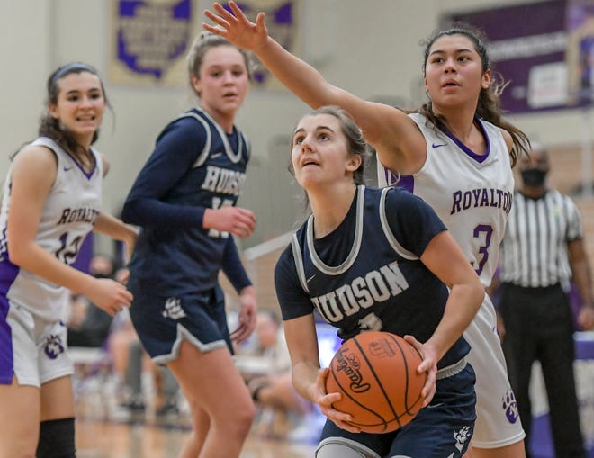 Hudson's Ali Menendez works under the basket against North Royalton's Jenna Kotlyn during the Explorers' 47-30 win Wednesday at North Royalton. Menedez led all scorers with 22 points.