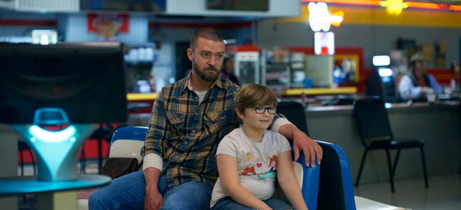 """This image released by Apple shows Justin Timberlake, left, and Ryder Allen in a scene from """"Palmer."""""""