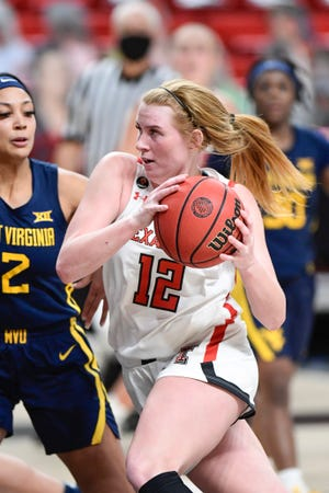 West Virginia guard Kysre Gondrezick (2) defends Texas Tech forward Vivian Gray on Wednesday night at United Supermarkets Arena. Gondrezick scored 24 points to lead No. 24 WVU to a 73-53 victory, its seventh in a row. Gray had 18 points and 10 rebounds for the Lady Raiders.