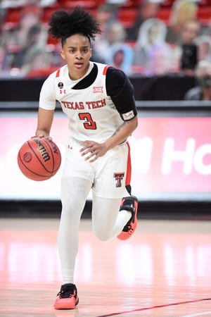 Texas Tech's Maka Jackson (3) controls the ball during the first half of a Big 12 Conference basketball game against West Virginia on Jan. 27 at United Supermarkets Arena. [Justin Rex/For A-J Media]