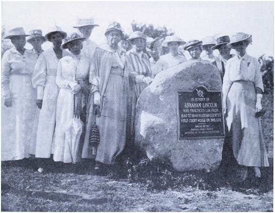 The Abraham Lincoln Chapter of the NSDAR is celebrating its 125th anniversary Saturday, January 30, 2021. This picture shows DAR daughters unveiling the commemorative stone and bronze plaque at the Postville Courthouse on July 4, 1917. It was one of the group's first major projects.