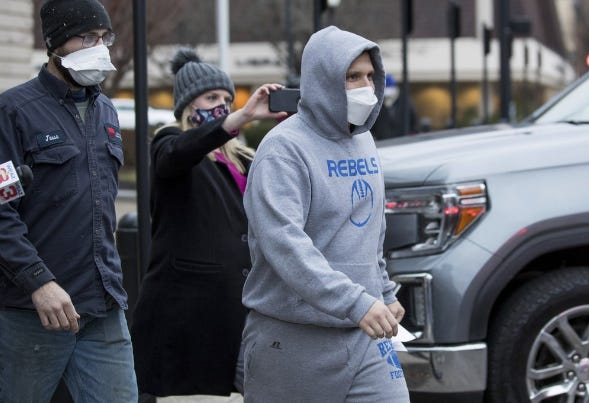 Former Del. Derrick Evans is shown in this AP photo as he was arrested for taking part in the Jan. 6 D.C. riot.