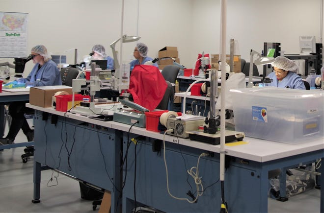 Workers at Tech-Etch Inc., a Plymouth-based precision-engineered parts maker for the medical device, aerospace and instrumentation industries, check the quality of parts at each phase of production.