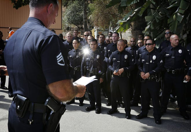 A sergeant speaks to a platoon of LAPD Metropolitan Division officers deployed in 2015 in Los Angeles as part of an effort to reduce crime. (Barbara Davidson/Los Angeles Times/TNS)