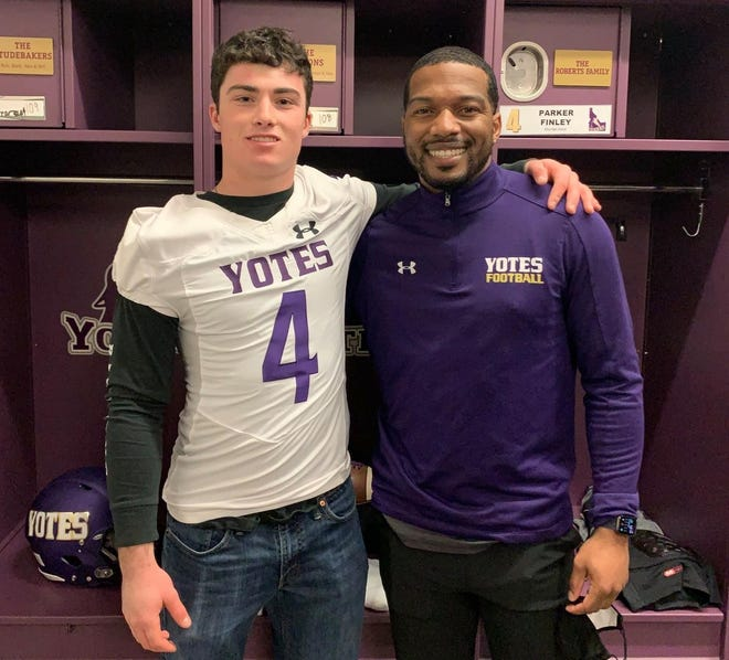 Parker Finley, left, of Etna High School, poses with College of Idaho assistant football coach Chandler Jones during a visit last weekend.