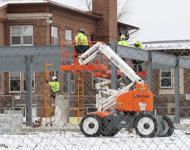 Workers check out the progress of the new building at the Livingston County Health Department on Torrence Avenue.