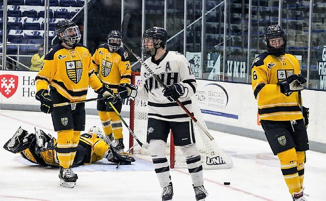UNH senior forward Eric MacAdams celebrates his goal in last Friday's 5-2 loss to Merrimack College.