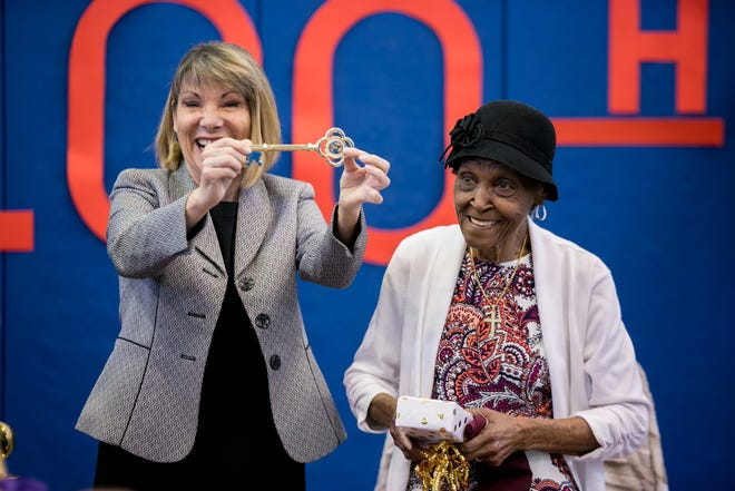 Tequesta Mayor Abby Brennan presents the key to the city to Ida Harris as she celebrates her 100th birthday with a party at the West Jupiter Recreation Center in October 2019.