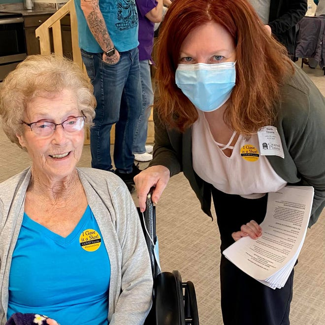 Grand Plains Administrator Beth Towns, checks in with a resident after they both received their first COVID-19 vaccination shot last Tuesday in Pratt. A clinical team from Walgreens administered the shots.