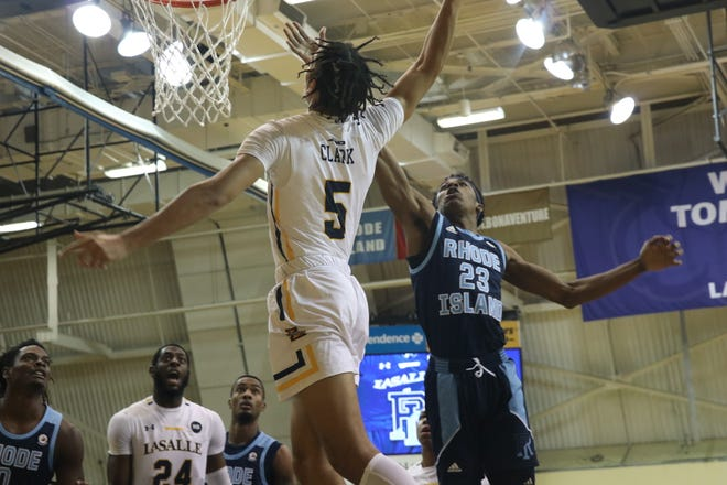 La Salle's Jack Clark goes in for a dunk Wednesday night while being defended by Rhode Island's D.J. Johnson.