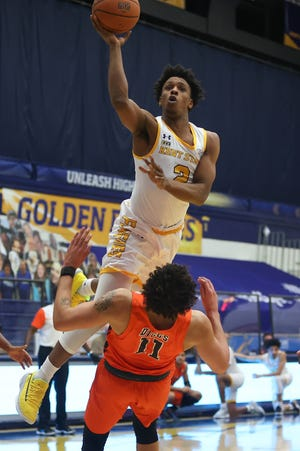 Kent State junior guard Malique Jacobs leaps over Bowling Green guard Trey Diggs during a game played last month at the M.A.C. Center.