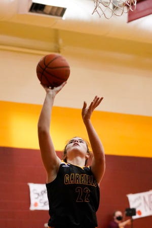 Garfield junior post Jenna Smith drives for an easy layup against Southeast on January 27, 2021.