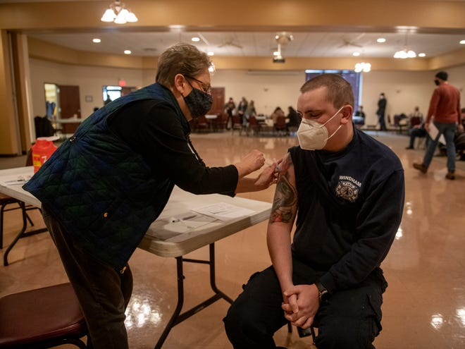 Jane Moser, Portage County Health Department MRC volunteer RN, administers a vaccination dose to Trey Brock, from the Windham Fire Department. While beginning work on the Phase 1B public vaccination process, the health department also is administering second doses to first responders.