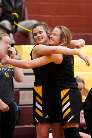 Garfield senior Grace Mills, right, celebrates with junior post Jenna Smith after being taken out of the game with about two minutes left against Southeast on January 27, 2021.