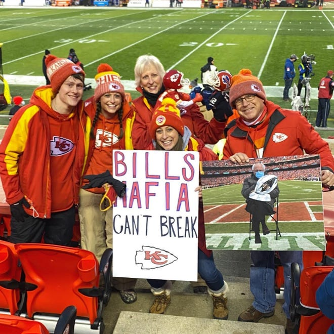 Ford Hall of Fans member Janel Carbajo and her family pose at the AFC Championship game last week between the Kansas City Chiefs and Buffalo Bills.