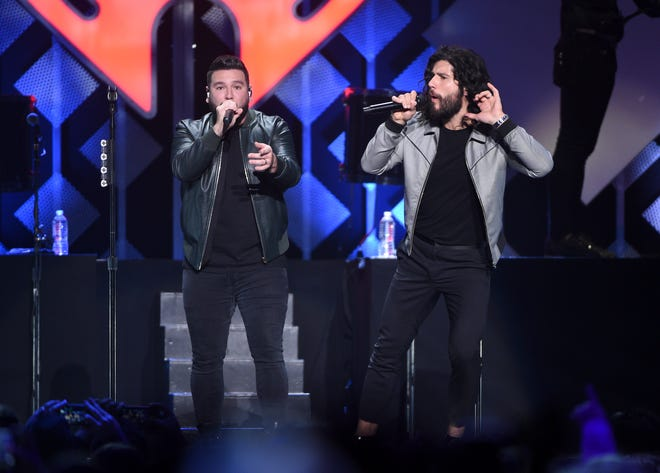 Singer-songwriters Shay Mooney (left) and Dan Smyers of Dan + Shay perform at Z100's iHeartRadio Jingle Ball 2019 at Madison Square Garden on Dec. 13, 2019, in New York. (Photo by Evan Agostini/Invision/AP)